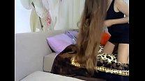Fantastic Long Haired Playing with Hair Brush Long Hair thumbnail