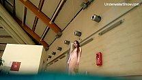 Redhead Simonna showing her body underwater