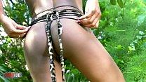 Horny ebony Bianka Blacka getting naked in the jungle Vorschaubild