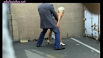 Blonde slut sucking a cock on the street
