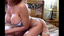 Big tit MILF  rubbing a hard cock