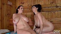 Luscious lesbians Joanna Bliss & Luna Amor suck each others' big titties thumbnail