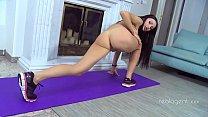 Flexible babe Sasha Rose makes exercises against the fireplace