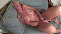 Busty blonde milf toys her twat Thumbnail