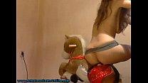 Hot Girl On Webcam Riding Toy Horse thumbnail