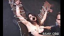 Bounded man endures pain as domina goes full bdsm on him