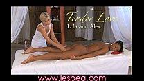 Lesbea Her oiled black body stiffens as an orgasm rips through her