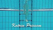 Redheaded Katrin is stripping underwater