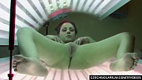 Screenshot Luxury Busty  brunette masturbates in solarium