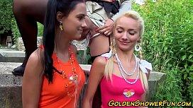 Busty lesbian urinates...