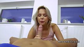 Blonde gives footjob in...