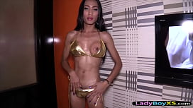Thai ladyboy in a gold bikini barebacked