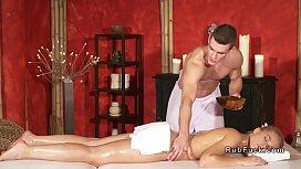Muscled masseur fucks toned...