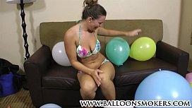 Busty teen pops balloons...
