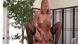 Hot blonde MILF in stockings fucks in the office