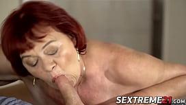 Redhead grandma gives head...