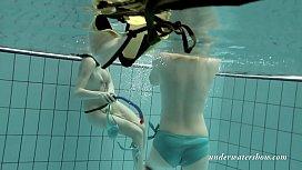 Girls swimming underwater and...