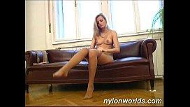 Nylon babe shows her...