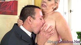 Buxom cougar blows cock