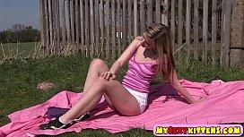 Sweet teenie pleasuring herself...