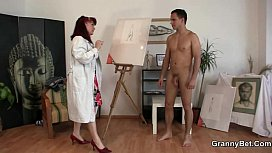 Mature paintress rides his...