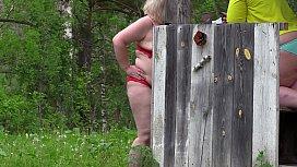 Voyeur outdoors spies on...
