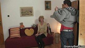 Blonde granny jumps on...
