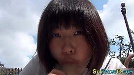 Japanese teen sucks dildo...
