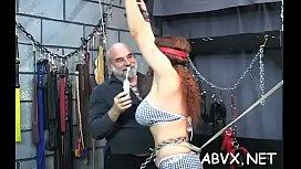 Stripped woman stands and endures rough bondage amateur