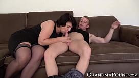 Lusty mature lady sucking...