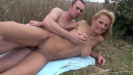 Big-titted Mature blonde...