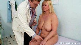 Big tits blond mature...