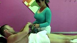 Busty real masseuse tugs...