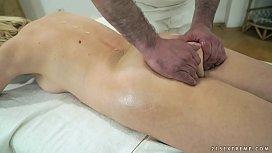 Older woman enjoys massage...
