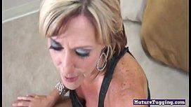 Busty mature beauty gives titjob and handjob