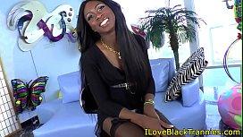 Stockinged black tgirl tugging...