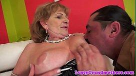 Busty grandma in stockings...
