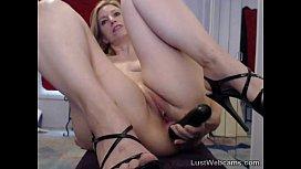 Blonde MILF toys her...