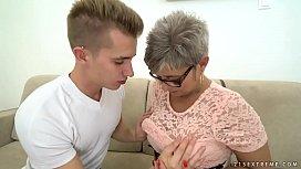 Grandma deepthroats a young...