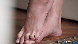 Babe gives kinky footjob...