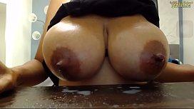 Cam girl sucks her own titties