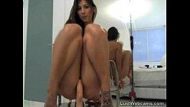Cute brunette rides dildo...