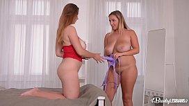 Busty lesbian Milfs Krystal Swift &amp_ Suzie enjoy strap-on XXX action at home
