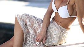 Sexy Capri Cavanni loses her bikini with the poolboy - PureMature