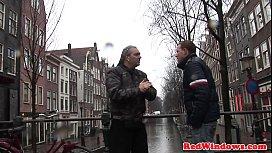 Dutch prostitute sucking tourist...