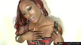 Redhead ebony T-girl...