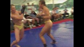 Topless women fight...