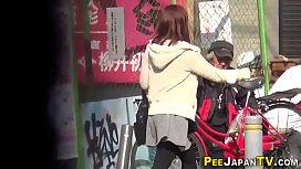 Asian teens pee on...
