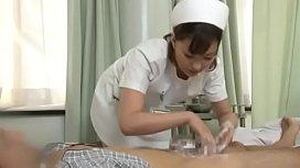 Sexy japanese nurse giving...