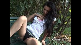 Horny young slut shows her pussy in a public park